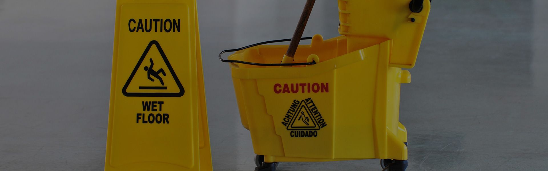 mop bucket and sign
